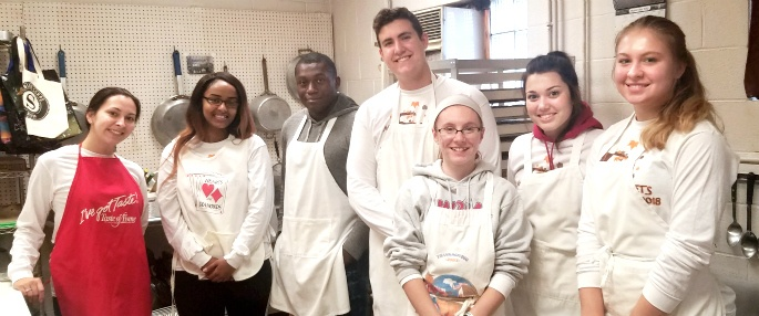 Students volunteering in soup kitchen