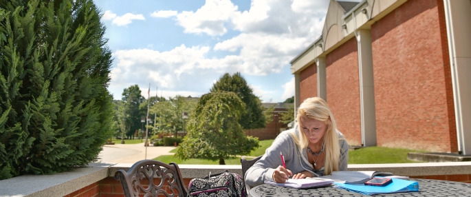 Pitt-Greensburg student studying outside
