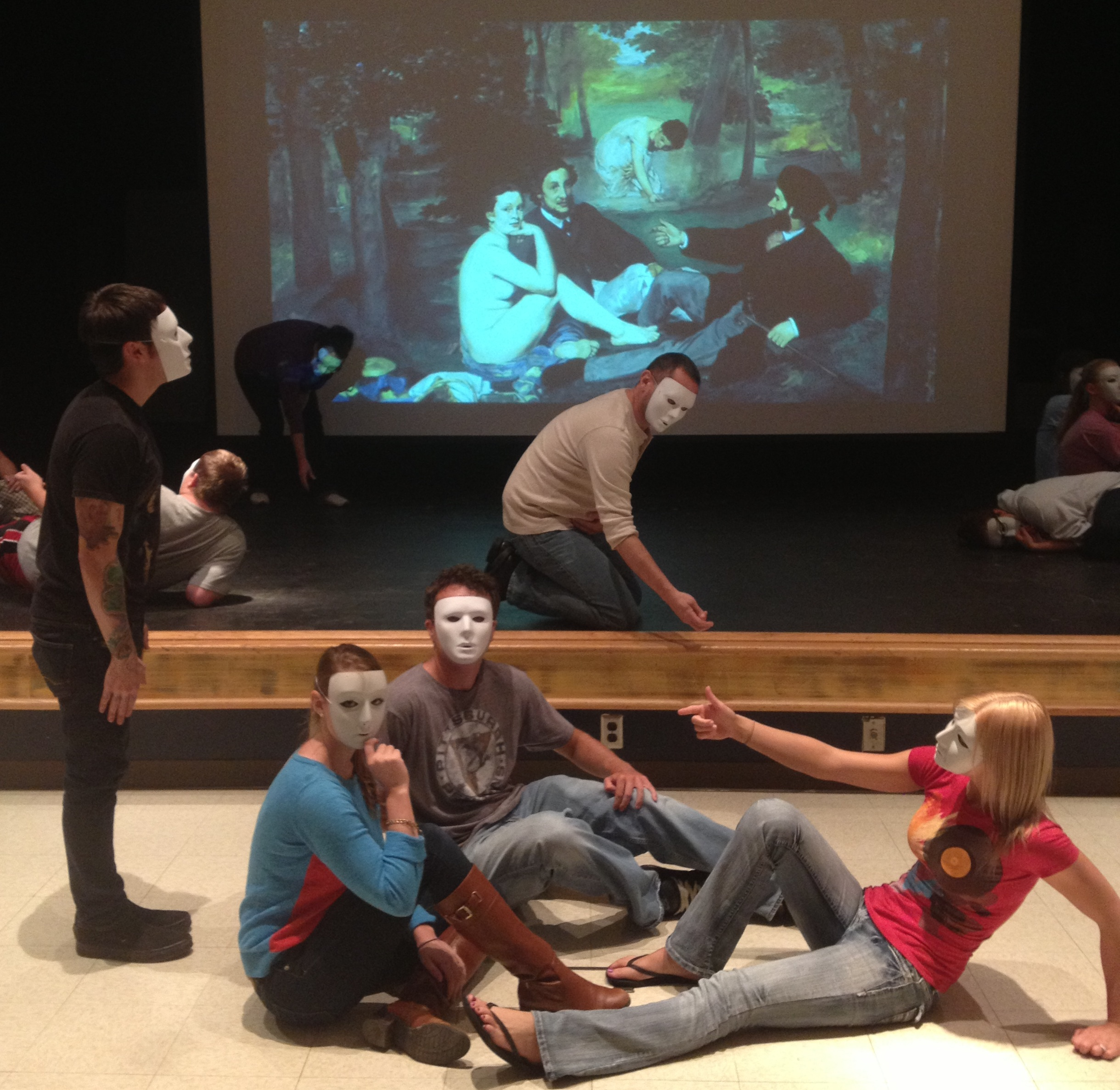 Students in the Advanced Acting class, using masks, create physical versions of famous paintings, both realistic and abstract.