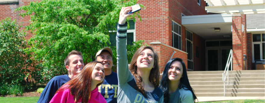 Students taking a selfie on campus