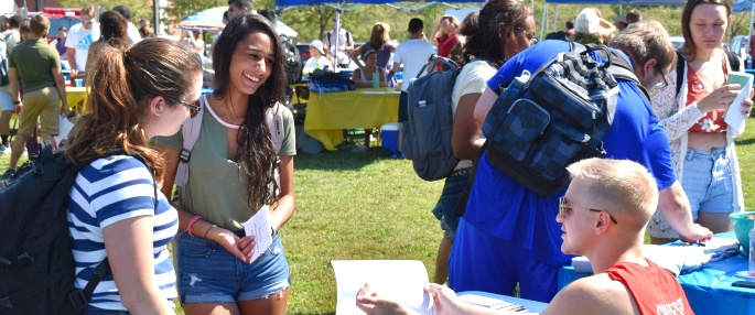 Students smiling at Student Activities Fair
