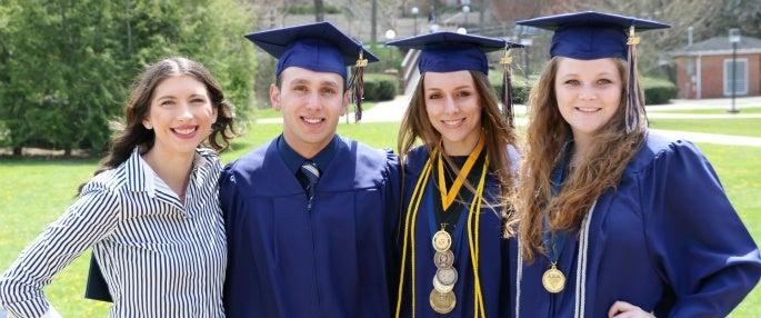 Friends smiling at graduation