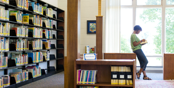 Pitt-Greensburg student reading in library
