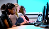 Students coding at computers